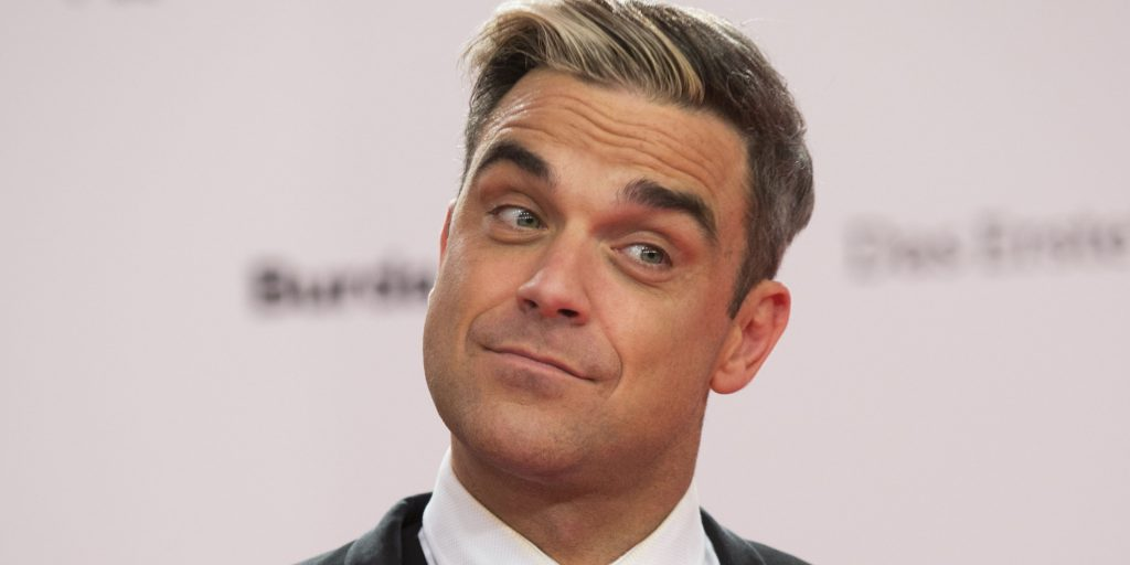Robbie Williams arrives for the Bambi 2013 media awards in Berlin, Germany, Thursday, Nov. 14, 2013. (AP Photo/Gero Breloer)